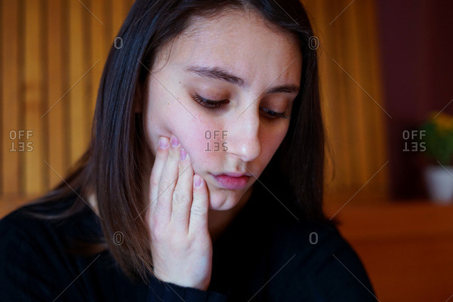 Young woman with toothache. Tooth pain concept.