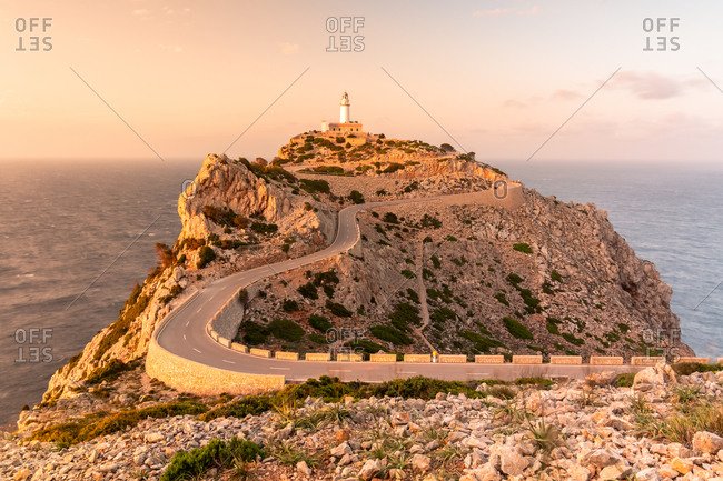 Cape Formentor lighthouse in Mallorca with the reddish tones of sunset