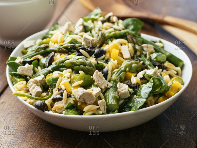 Home made asparagus, spinach orzo salad with vegan feta Cheese