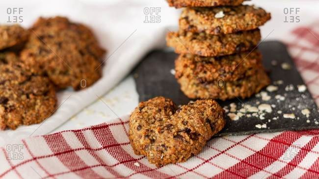 Homemade oatmeal and chocolate cookies in the shape of a heart on a who