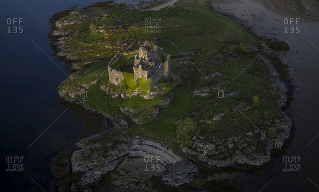 Aerial drone shot of Castle Tioram, it is a ruined castle in Scotland