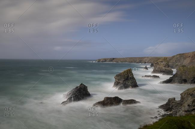 Tide rushes over rocks near the Bedruthian Steps, Cornwall.