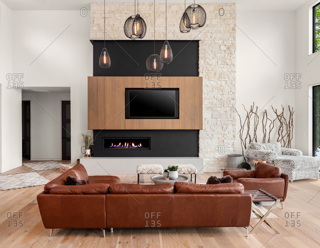 Beautiful living room in new modern luxury home with large fireplace