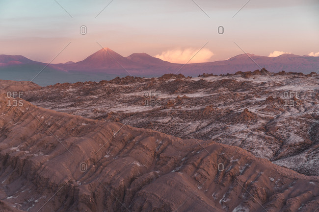 Desert Ridgeline in Atacama with scenic volcanos in the background