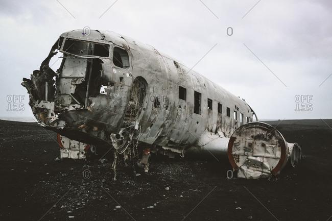 Vik, Iceland - January 5, 2017: Closeup shot of Solheimasandur plane wreck DC-3 on black sand beach