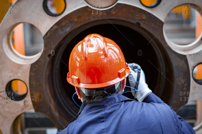 Offshore operator inspects pipe and flange before install