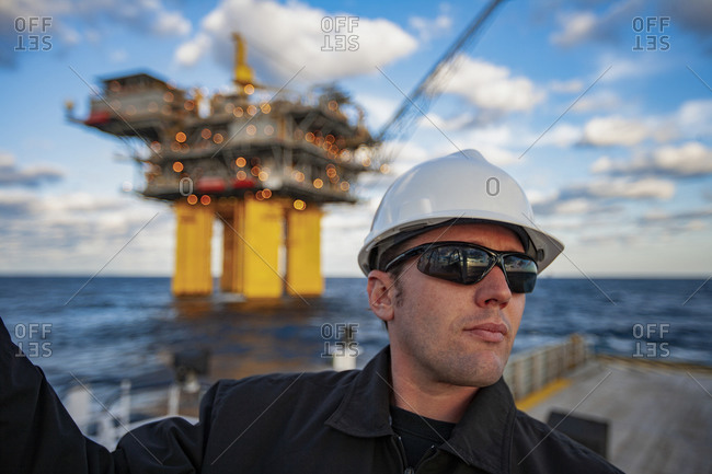 Offshore energy production with person on ship