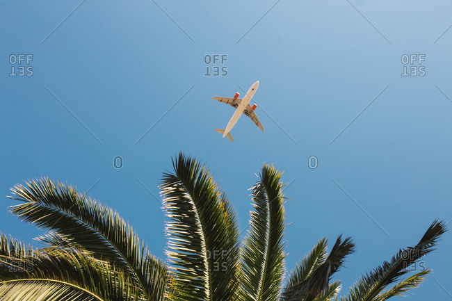 Bottom view of airplane in the sky