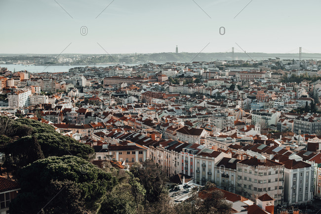 Aerial panoramic wide angle view of Lisbon: tiled roofs, river