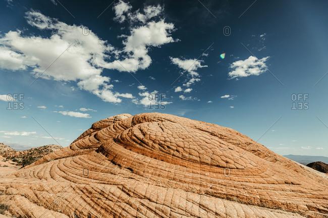 circular patterns of petrified sand dunes on red rock in utah desert
