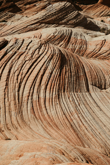 waves of pattern on petrified red rock sand dunes in southern utah