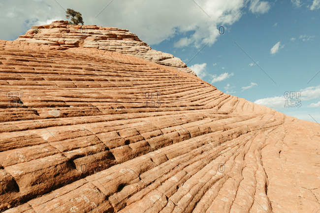 diagonal lines of red rock in petrified sand dunes of southern utah