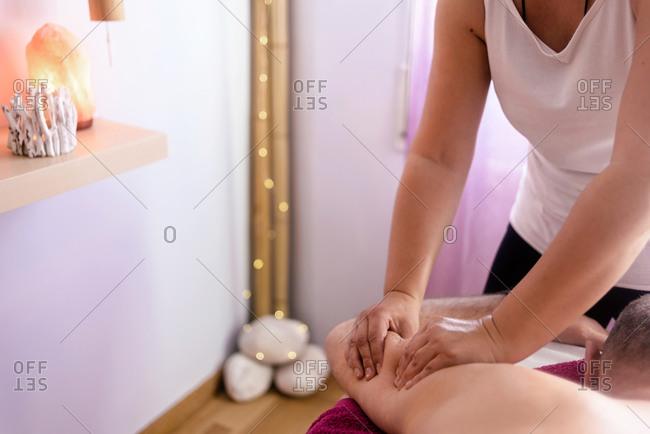 Female masseuse massaging a patient's arm
