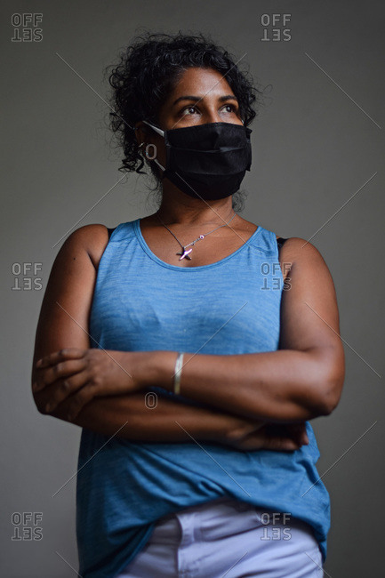 Interior portrait of woman wearing a face mask