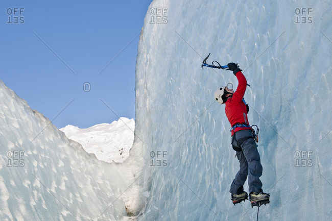 Woman climbing on the Fjallsjokull glacier in Iceland
