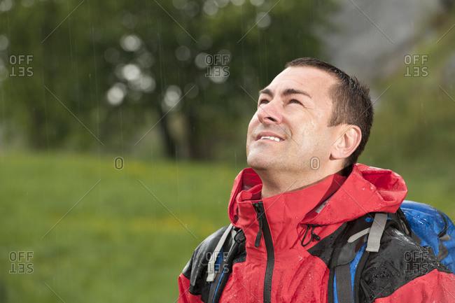 Man hiking in the rain in England