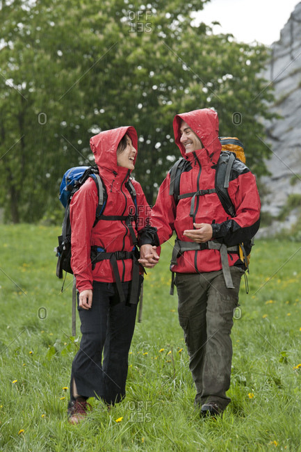 Couple hiking in the rain in England