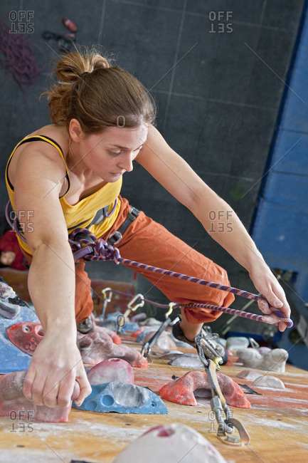 Woman training at indoor climbing gym