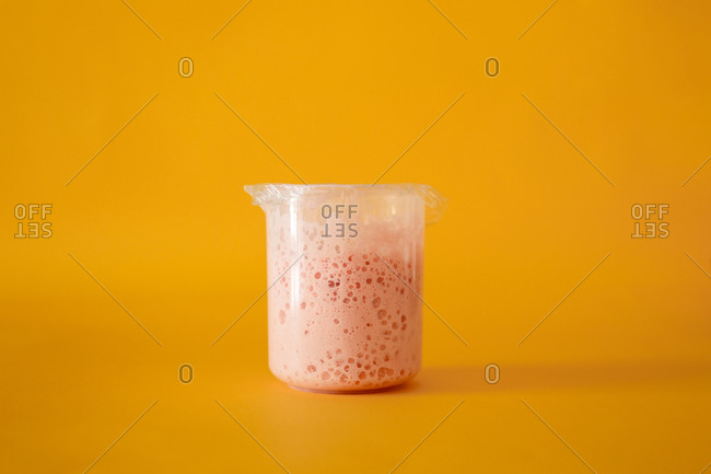 Pink dough with yeast on an orange background. Abstract Image