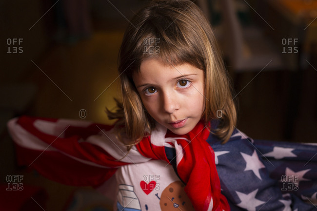 6-year-old girl dancing wrapped in the U.S. flag