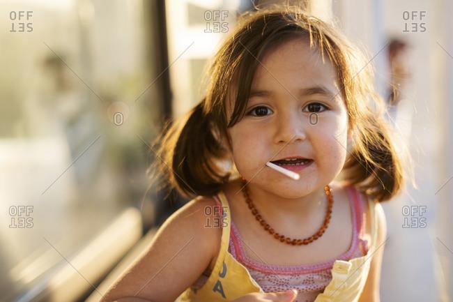 Little girl eating a lollipop