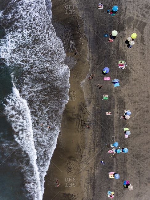 People on the beach keeping the required social distance during the Covid 19 outbreak