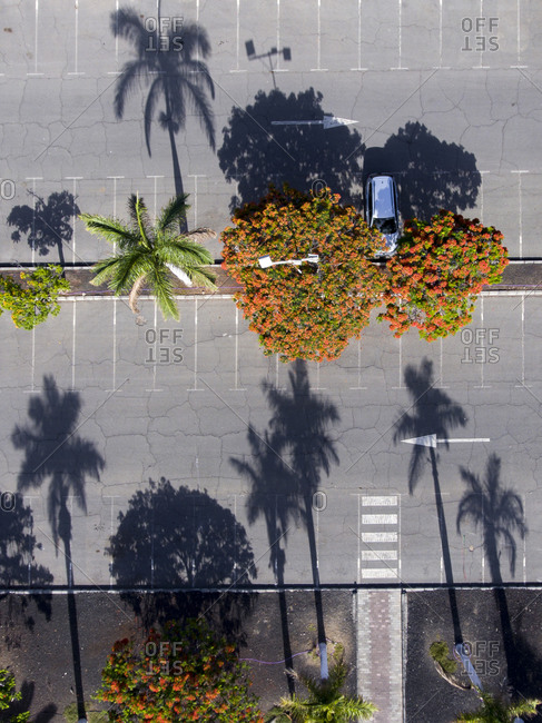 A car parked in a parking lot viewed from above