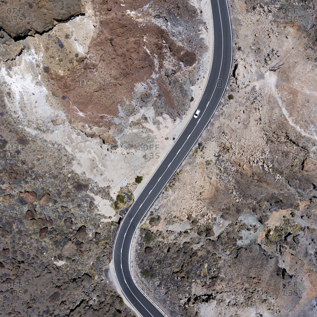 Bird's eye view of a car driving on a mountain road