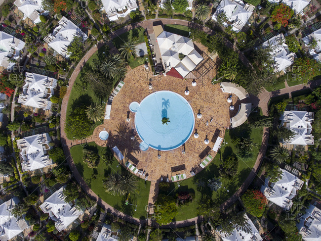 Aerial view of a round pool in a residential area