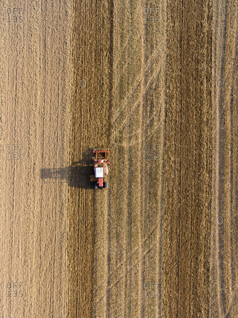 Bird's eye view of a tractor plowing a field