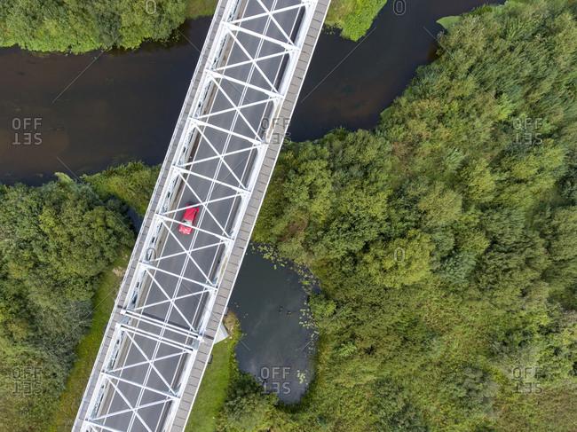 Car driving on a bridge across the river