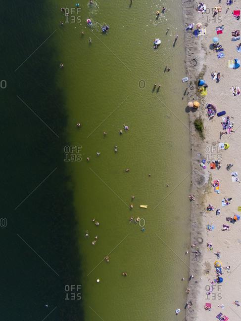 Bird's eye view of beachgoers enjoying a day at the lake