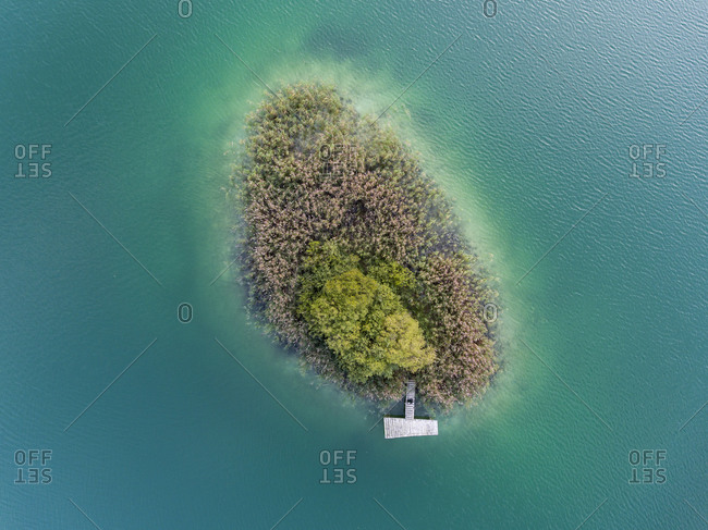 Small island with boat dock in the lake