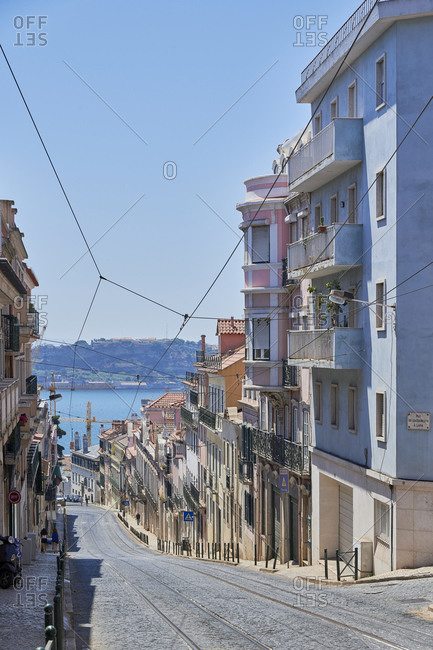 Multicolored facades of apartments in the Lapa neighborhood in Lisbon, Portugal with view of Tagus River