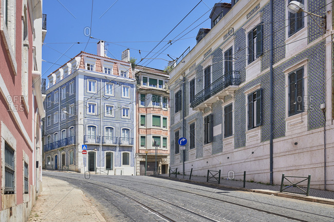 Tiled apartments on street with tram railway in the Lapa neighborhood in Lisbon, Portugal