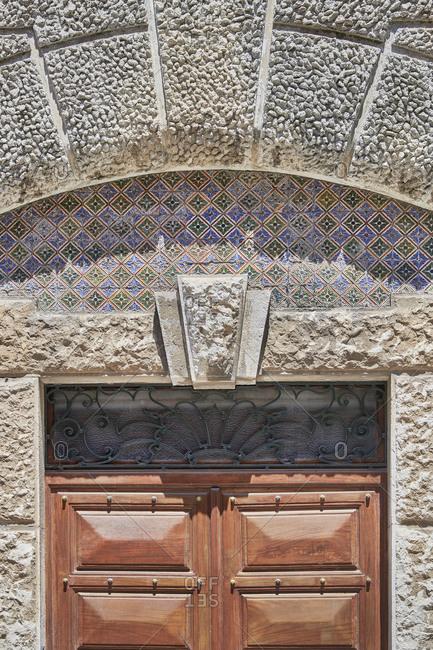 Wooden door with decorative tile above, Lapa neighborhood, Lisbon, Portugal