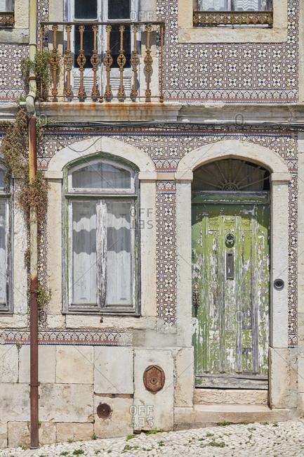 Home exterior with Moorish tile around window and door, Lapa neighborhood, Lisbon, Portugal
