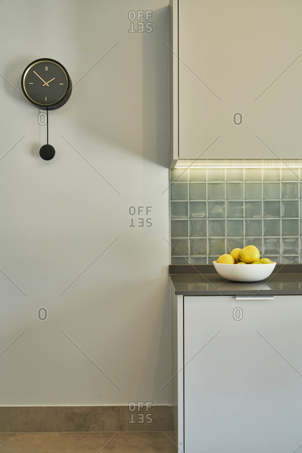 Modern kitchen with gray counters and cabinets in Lisbon, Portugal