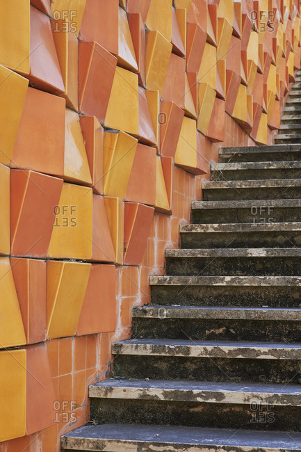 Orange and yellow 3D facade of building in the Lapa neighborhood, Lisbon, Portugal