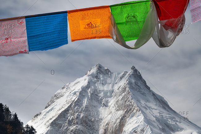 October 29, 2019: View of the Manaslu (8163 m) with prayer flags, Nepal