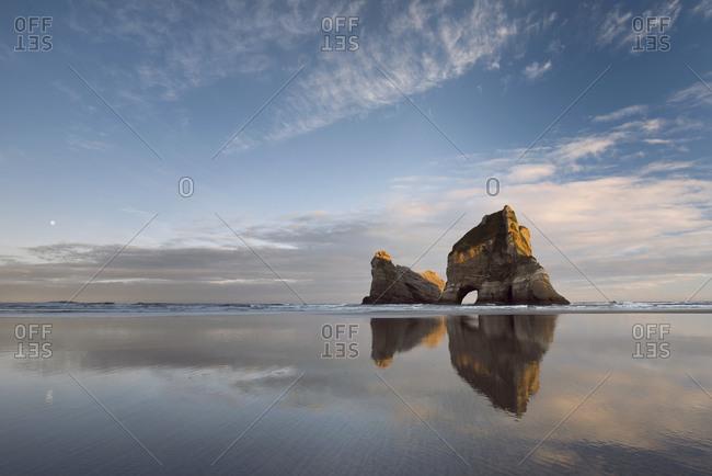 Archway Islands at sunrise with reflection, Wharariki Beach, Golden Bay, Tasman, New Zealand