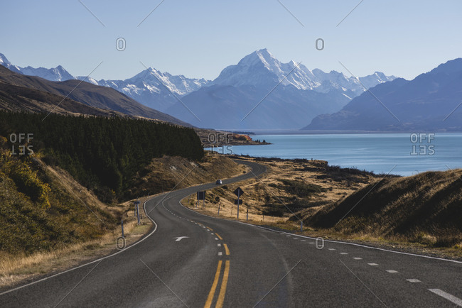 Curved road on Lake Pukaki with Mt Cook in the background, Canterbury, New Zealand