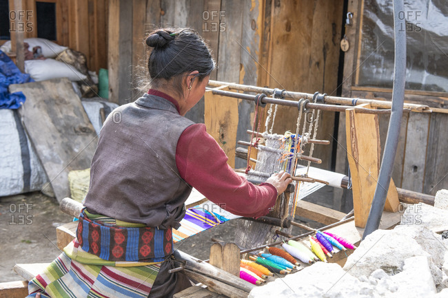 Nepalese woman at the loom