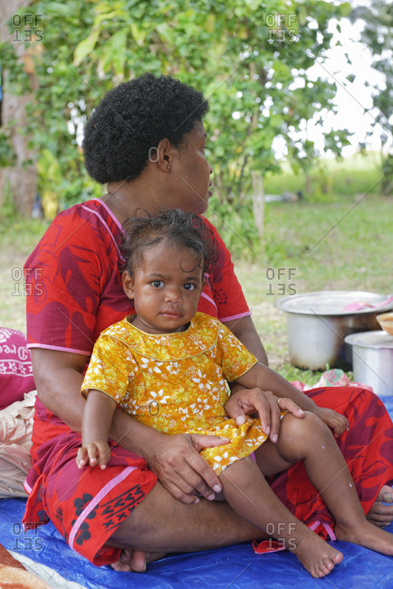 July 25, 2019: Mother and daughter during village ceremony, Yasawa island group, Fiji, South Pacific islands