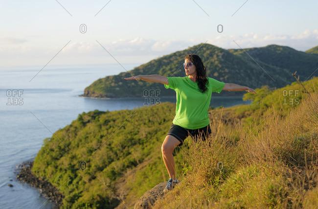 Woman practicing yoga, Drawaqa Island, Yasawa island group, Fiji, South Pacific islands