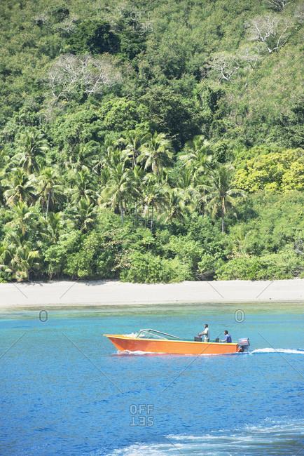 July 26, 2019: Boat navigating near Yasawa island, Yasawa island group, Fiji, South Pacific islands
