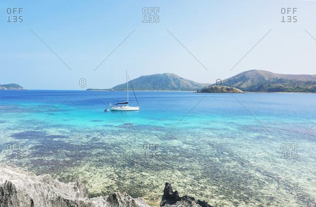 Boat sailing near Yasawa island, Yasawa island group, Fiji, South Pacific islands