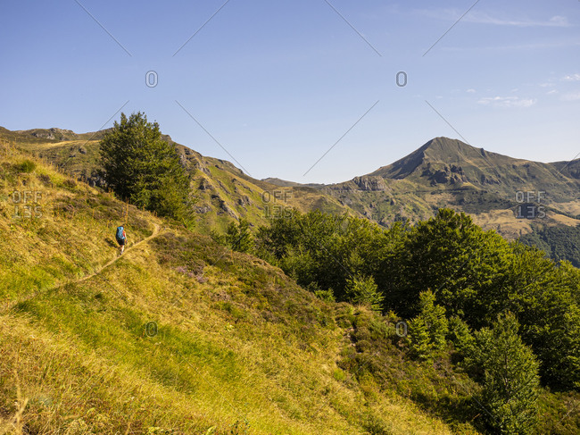 Trekking in the Cantal, volcanic mountains in France, ascent from Mandailles towards Puy Chavaroche