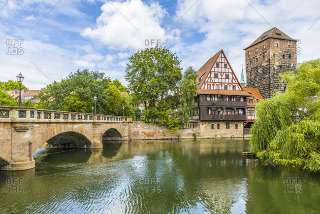 Medieval Maxbrucke (arch bridge), over the Pegnitz in Nuremberg, right Weinstadl and water tower,