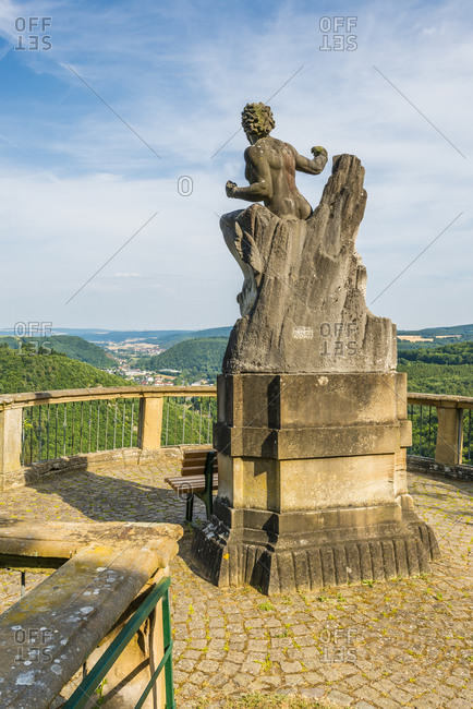 July 11, 2015: Prometheus statue in castle ruins, high above the Kellenbach valley, Germany